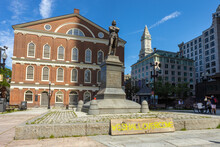 """Faneuil Hall In Boston Massachusetts With Sign """"We Shall Overcome"""" Placed At The Base Of The Samuel Adams Statue"""