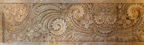 Fototapeta Marble Hindu style floral patterns carved into the exterior wall of Baron Empain