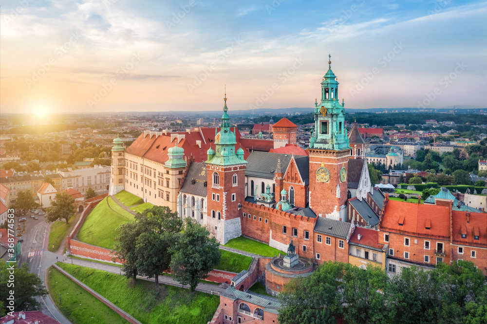 Fototapeta Krakow, Poland. Aerial view of Clock Tower in Wawel Royal Castle on sunrise
