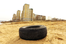 The Car Tire Lies Against The ...