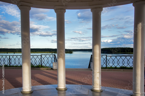 White air Rotunda on the high Bank of the river Wallpaper Mural