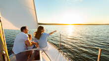 Family Of Three Sailing On Yacht At Seaside Outdoor, Panorama