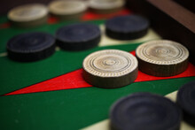 Macro Closeup Of Isolated Backgammon Board With White And Black Checkers
