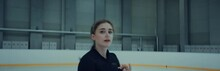 Professional Female Ice Figure Skater Practicing Spin On Indoor Skating Rink Shot On RED Cinema Camera With 2x Anamorphic Lens, 75 FPS Slow Motion
