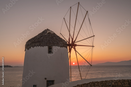 Fototapety, obrazy: Traditional windmills, the symbol of Mykonos at sunset, Greece