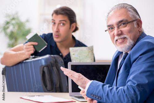 Fototapeta Young man visiting embassy for visa application obraz na płótnie
