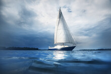 Blue Sloop Rigged Yacht Sailin...