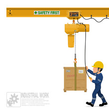 An Industrial Worker Is Operating Electric Chain Hoist