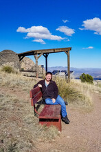 Girl Sitting On A Bench At Coronado Peak In Arizona