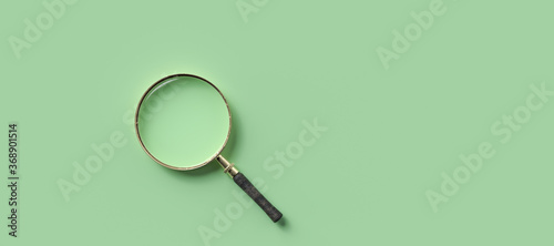 magnification glass on the left on empty green background Fototapet