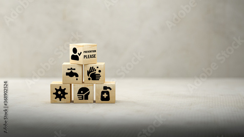 Obraz cubes with anti-virus tips and message PREVENTION PLEASE on concrete background - fototapety do salonu