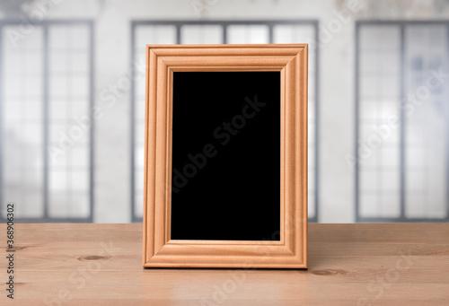 Obraz old photo frame on the wooden table - fototapety do salonu