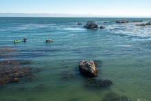 Kayaking Along Rocky Shore, Pismo Beach, California Coastline