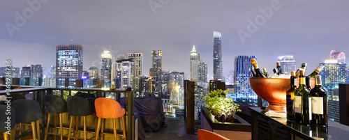 Fototapeta Bangkok city view point from rooftop bar, overlooking a magnificent cityscape blue sky and city light, Thailand obraz