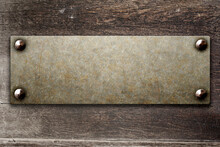 Grunge Background With Metallic Plate On Wood Board
