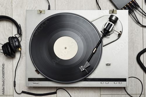 Vinyl player with long play or LP record and headphones. Fotobehang