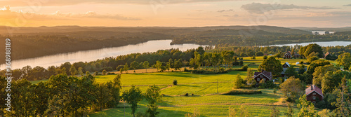 Rural sunset panoramic view at the swedish coutry side during golden hour