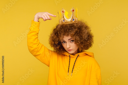 Look, I am best! Selfish haughty curly-haired woman pointing at crown on head and looking with arrogance supercilious, being egoistic with over-inflated ego Canvas Print