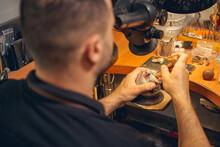 Craftsman Setting Pheonites In A Jewelry Item
