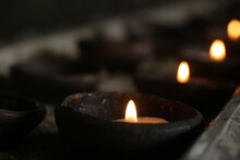 Candle Lights On A Traditional Ceramic Bowls On Dark Background. Holy Week Concept. Spiritual Concepts.