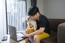 Man Cuddling With His Dog Whil...