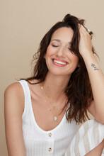 Happy Woman Wearing Shell Jewellery