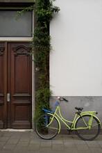 Vintage Style Bike Left Outside House In Bruges