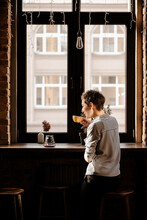 Woman Drinking Coffee Against ...