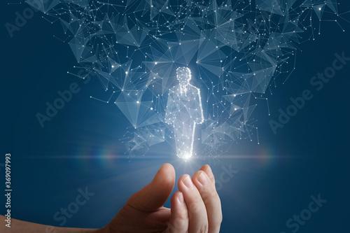 Fotografia, Obraz Hand shows a hologram of a human worker .