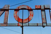 Old Motel Sign Against Vivid Blue Sky