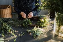 Woman Florist Assembling A Garland