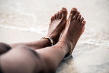 Woman Legs Barefoot In A Sandy...