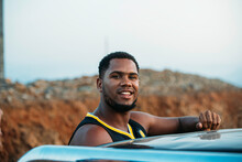 Content Casual African American Man Standing Beside Car