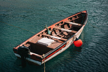 Shabby Fishing Boat Floating In Sea Water