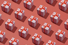 Trendy Pattern Made From Present Gift Boxes On Red Background
