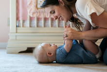 Family: Mother Teaching Baby G...