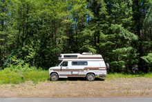 A Wide Shot Of A Camper Van Parked Off Of The Road