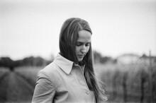 A Beautiful Portrait Of A Woman In A Vineyard