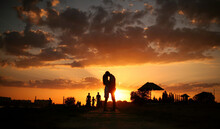 Kissing Couple In A Beautiful Sunset