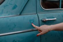 Girl Draws A Heart On An Old Car