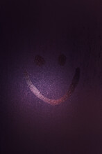 Smiling Face Drawn On A Wet Wi...