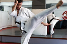 Man Practicing Karate In The S...