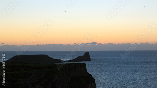 Worm's Head at Rhossili Bay on the beautiful Gower peninsular at sunset - Wales Wallpaper Mural
