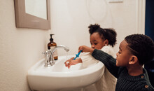 Brother And Sister Brushing Te...