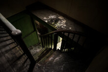 Looking Down A Staircase In An...