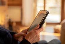 Woman Reading Book From An Electronic Tablet