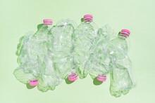 Plastic Bottles On Green Background.