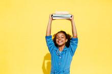 Glad Black Girl Holding Textbo...