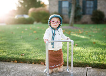 Toddler Girl Dresses Up As Old Lady With Walker For Halloween