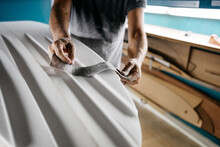 Anonymous Shaper Making A Surfboard